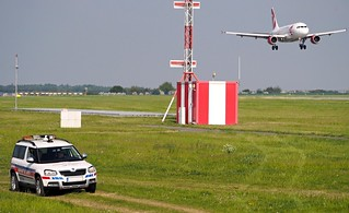 the security guard of the Václav Havel airport observes the landing of the A319-112 OK-MEL ČSA Czech Airlines Airbus