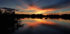 Sunset over flooded fields in Ban Mai 8 (SierraSunrise) Tags: thailand isaan esarn phonphisai nongkhai skies sky clouds reflections rivers flooding flooded mekongriver water mekong sunset