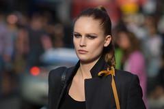 Departing Soho (Stuart Mac) Tags: beauty gorgeous face woman soho street candid london 135mm nikon walking light colour