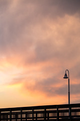 Dusky Hues (haddartist) Tags: oceanside coast coastal pier railing light pole lamp wood wooden silhouette silhouetted sky clouds cloudy sunset dusk evening color colorful simple simplicity minimal minimalism tranquil tranquility peaceful sandbridge virginiabeach virginia
