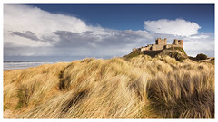 Bamburgh Castle (S.R.Murphy) Tags: bamburgh bamburghcastle canon24105 canon6d coast coastallandscape seascape sky clouds dunes photoshop oilpaintfilter lightroomcc photoart digitalart northumberland england britain