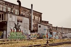 Restmore Building - Parker Street (kenyoung3) Tags: restmorefurnitureandbedding graffiti falsecreek vancouverbc trackside warehousing texture