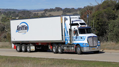 Jerrawa Climb (2/6) (Jungle Jack Movements (ferroequinologist)) Tags: jerrawa yass nsw new south wales hume highway southern refrigerated transport volvo kenworth red blkue circle cement hp horsepower big rig haul haulage freight cabover trucker drive carry delivery bulk lorry hgv wagon road nose semi trailer deliver cargo interstate articulated vehicle load freighter ship move roll motor engine power teamster truck tractor prime mover diesel injected driver cab cabin loud rumble beast wheel exhaust double thurgoona mack central coast hoyhaul griffin eades