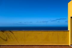 The terrace by the sea (Rita Eberle-Wessner) Tags: canaryislands canarios islascanarias kanaren kanarischeinseln lapalma tazacorte meer ocean ozean atlanticocean atlantik wasser sea blau blue azul himmel sky clouds horizont horizon terrasse terrace yellow gelb kontrast komplementärkontrast complementarycontrast lines linien architektur grafisch grafic architecture eckenläufer