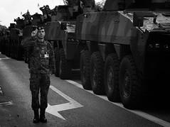 . (konrad.lubanski) Tags: street man soldier salute independence day black white bw olympus omd em5 poland army armored vehicles rain