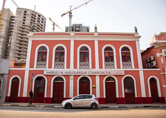 Old portuguese colonial building in front of a new skyscraper, Luanda Province, Luanda, Angola (Eric Lafforgue) Tags: africa angola angola180506 architecture buildingexterior builtstructure capitalcities car city cityscape colonial colonialhouse colourimage constructionsite crane day developingcountries exterior facade horizontal luanda marginal outdoors photography portuguesecolony renovation tourism traditionallyportuguese travel traveldestinations luandaprovince ao