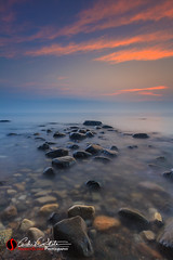 Subtle Beginning (andrewslaterphoto) Tags: atwater greatlakes lakemichigan milwaukee nature outdoors rocks sunrise water beach clouds dawn mke mkemycity morning shorewood boulder fog subtle calm longexposure discoverwisconsin travelwisconsin horizon andrewslaterphotography canon leefilter