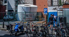 2018 - Belgium - Gent - TP for You (Ted's photos - Returns Late November) Tags: 2018 belgium cropped ghent nikon nikond750 nikonfx tedmcgrath tedsphotos vignetting tp toiletpaper ad advertising bikes bicycles fence fencing scooter steps stairs shadow shadows bikers helmuts ghentbelgium