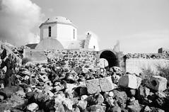 Rock and a church (•Nicolas•) Tags: analog bw film fp4 greece holidays ilford ilfosol leica m4p nb pellicule vacances pyrgos church église rocks rochers wall mur nicolasthomas