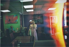 iamundernodisguise (jesuiselouise) Tags: 35mm lomography analog girl light leaks lofi summer dress falafel restaurant braun new technik indoor