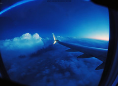 Chasing the Sun (Infinity & Beyond Photography) Tags: plane airplane window seat view aircraft wing clouds sky 8mm samyang fisheye winglet 737 alaskaairlines