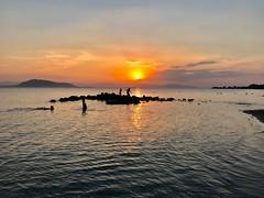 Children on the rocks. (AchillWandering) Tags: monochrome marathonas beach dream children coast sunset rocks sea greece aegina nature village golden water