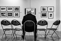 Appreciating Art 077 (Peter.Bartlett) Tags: chair ricohgr niksilverefex art unitedkingdom people streetphotography westyorkshire peterbartlett man urban candid uk wall bw kirklees huddersfield blackandwhite noiretblanc monochrome england gb