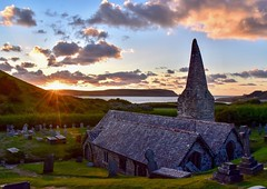 St. Enodoc's Church at Sunset (rustyruth1959) Tags: gradeilisted hill grass johnbetjeman poet tombs belfry trefoil broachspire clouds sky evening dusk water sea headstones camelestuary coast dunes stepperpoint sunset slate rubble sinkingneddy buriedchuch tower religiousbuilding sanddune stenodoc'sgolfcourse goldcourse church stenodoc'schurch daymerbay trebetherick cornwall kernow england alamy uk nikon1855mm nikond5600 nikon