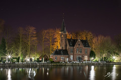 Port (TVZ Photography) Tags: gothic architecture tower building trees lights reflections water bruges brugge westflanders belgium lakeoflove minnewater night evening longexposure lowlight sonya7riii zeiss loxia 21mm