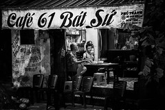 Ninh Binh (Rod Waddington) Tags: vietnam vietnamese binh ninh cafe customers diners blackandwhite monochrome mono nightphotography night chairs sign men people candid streetphotography