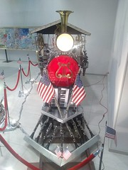 Loco-Motion (PhotoJester40) Tags: indoors inside artprizeentry2018 musicalinstruments train creative locomotion americanflags flags keyboards