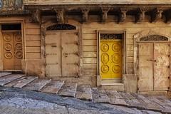 Maltese Doors (Douguerreotype) Tags: yellow city stairs steps buildings gold street malta architecture valletta urban door
