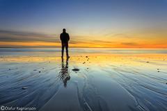Old man on the beach (Ó.Guð) Tags: hafnarfjörður hafnarfjordur iceland icelandic sunsetcolor sun shore fjara sandur steinar steinn stone strönd óguð ogud olafurragnarsson ólafurragnarsson old oldman beach sea ocean sky sand water sunset