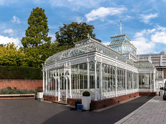 Victorian conservatory at the Horniman Museum (Keith in Exeter) Tags: victorian conservatory horniman museum gardens building gradeiilisted restored architecture london england wall hedge shrub tree sky paving