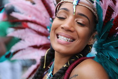 Gold Teeth Smile (Chuck Diesel) Tags: nottinghillcarnival2018 london masquerader people woman parade smile eyesclosed teeth gold