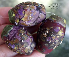 Rocks Grape Wine Vitraux (Laura Blanck Openstudio) Tags: openstudio openstudiobeads glass handmade murano lampwork beads set jewelry rocks nuggets pebbles stones whimsical funky odd colorful multicolor abstract asymmetric earthy organic sterling silver silvered fine arts art artist artisan made usa violet purple grape eggplant plum mauve lilac lavender ocher relics copper green matte etched frosted opaque glow glowing red burgundy bordeaux wine pistachio brown amber maroon raku yellow fuchsia orquid kaleidoscope