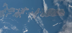 Indonesian Islands (sjrankin) Tags: 20september2018 edited nasa iss iss056 iss056e173937 indonesia islands clouds