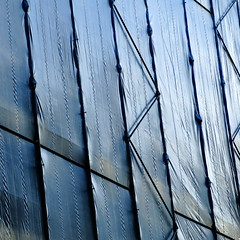 slant (vertblu) Tags: covering slant scaffolding scaffold covered cover tarpaulin tarp coveringsheet dropcloth constructionwork buildingwork framework geometric geometrical geometry abstractfeel almostabstract abstractstyle lines pleats crinkled wrinkled wrinkle crinkles crinkle sidelight sidelit diagonal bsquare 500x500 lightblue blue linien texture textur texturesquared textures vertblu folds pattern patterning