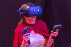 Female visitor with cape gaming with VR headset and controllers (marcoverch) Tags: e3 cologne deutschland kölnmesse messe fusball zocken games germany computerspiele gamescom cosplay 2018 köln gaming performance music musik concert konzert adult erwachsene people menschen singer sänger one ein musician musiker stage bühne portrait porträt festival woman frau retrato candid vacation classic ford door farm eos dragonfly cathedral femalevisitor cape vrheadset controllers