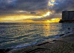 Solar Radiation (jcc55883) Tags: sunset sky clouds ipad waikiki sunsetphotography shoreline kuhiobeachpark hawaii oahu luckywelivehawaii 808 ocean pacificocean shore surf sand reflection silhouette honolulu