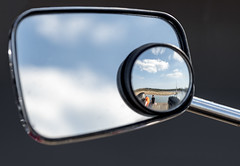 Behind you (David Feuerhelm) Tags: mirror nikkor reflection clouds coast water harbour sea blue scooter shore people nikon d750 70200mmf28