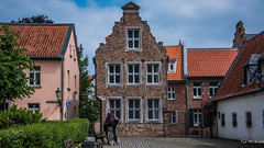2018 - Germany - Kaiserswerth - Street Scene (Ted's photos - For Me & You) Tags: 2018 cropped germany kaiserswerth nikon nikond750 nikonfx tedmcgrath tedsphotos vignetting bicycle building kaiserswerthgermany windows doors streetscene street brickwall backpack
