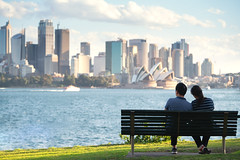 Asian couple sit and relax after running in a park in sydney (I love landscape) Tags: sydney house australia opera harbour park landscape bench architecture view city tourist bridge skyline young cityscape new modern travel building urban landmark sitting nsw people person business background white water space south wales sit tourism woman exterior alone destination downtown buildings district love beautiful couple blue front sunrise green public