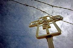 East Van Cross (Beaulawrence) Tags: film analog lomography 35mm sureshot canon point shoot cheapcamera fuji fujifilm fujichrome provia provia100f slidefilm e6 homedeveloped homedarkroom diy unicolor photoblog vancouver bc cananda eastvan cross publicart kenlum barbwire