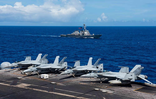 USS Benfold gets underway with the aircraft carrier USS Ronald Reagan during a photo exercise for Valiant Shield 2018
