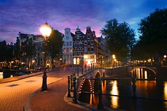 Keizersgracht Canal Corner Light (l.cutolo) Tags: tourism architecture water worldtrekker citylights zeisslens amsterdam bridge intensecolors sky tulip ononeraw holland citylife city lucacutolo canal flowers ams citycentre sunset monument sharp art vignette lighttrails tlp reflections sonya7ii cityscape ngc europe canalboat sony colours world sonyfe2470mmf40zaoss