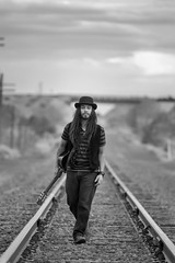 Ruben Vail, AKA singer/songwriter Synyster Vail, at Cerrillos (Mitch Tillison Photography) Tags: artistic fine art black white editorial portrait musician creative singer songwriter guitar guitarist rails railroad atmospheric dark mysterious traveler sojourner synystervail performer talent talented stillunderground artist nikon mitchtillison photo shoot photography d5 nikkor 300mm f4