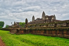 Angkor Wat near Siem Reap, Cambodia (UweBKK (α 77 on )) Tags: angkor wat angkorwat temple ruins architecture gallery terrace naga archeological park archeology history historical ancient culture religion religious grey sky clouds green grass siem reap siemreap cambodia southeast asia sony alpha 77 slt dslr