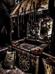 The Smithie (Steve Taylor (Photography)) Tags: christchurch canterbury southisland nz newzealand blacksmith forge furnace lowkey wheel ironwork tongs hook horseshoe sack irons architecture digitalart black brown metal shadow texture