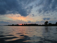 Back to the put-in (deanspic) Tags: canoescape cloudscape clouds red september sunset river reflection canoe canoeing paddle paddling freedom bow boat kayak hybrid vivid glorious balance symmetry horizon colour color intense paddleon stlawrenceriver art g1x