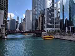 Traffic (ancientlives) Tags: chicago chicagoriver illinois il usa riverwalk taxi yellow architecture buildings towers city cityscape skyline skyscrapers glass water river walking september tuesday 2018 summer