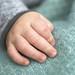 The tiny man's hand