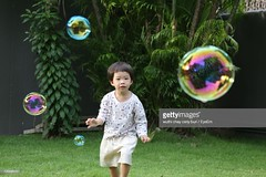 726868281 (pockethifi) Tags: recreationalpursuitoutdoorschildrenonlymotionchildhoodfra recreationalpursuit outdoors childrenonly motion childhood fragility child multicolored innocence oneboyonly oneperson bubble boys playing males running 23years horizontalimage