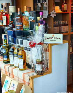 Scotland West Highlands Argyll Oban a shop selling Whisky's and Havana Cigars 7 July 2018 by Anne MacKay