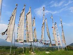 Tibetan Flags (Give-on) Tags: asia nepal pokhara tibetanprayerflags tibetan refugee village flags colorful sky