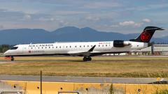 Bombardier CRJ-705 C-FCJZ Air Canada Express (William Musculus) Tags: vancouver international airport yvr cyvr spotting richmond britishcolumbia canada ca cfcjz air express bombardier crj705 cl6002d15 crj900 canadair regional jet qk jza jazz ac aca william musculus