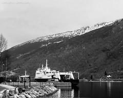 Waiting... (natureflower) Tags: ships lake mountain rocks pier port bw monochrome reflection