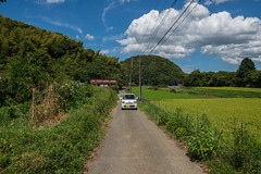 K-car with round eyes. (Yasuyuki Oomagari) Tags: mountain country countryside rural sunny white car kcar green japan kyushu fukuoka nikon zeiss d850 distagont2821 日本 九州 福岡県 風景写真 田舎 rice field