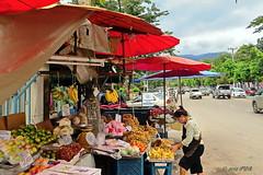 Chiang Mai. (ol'pete) Tags: chiangmai thailand เชียงใหม่ ประเทศไทย เมืองไทย street vendor stall traffic fruit earthasia