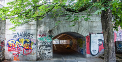 2018 - Germany - Munich - Tunnel Vision (Ted's photos - For Me & You) Tags: 2018 cropped germany munich münchen nikon nikond750 nikonfx tedmcgrath tedsphotos vignetting tunnel graffiti munichgermany arch wall opening roadway